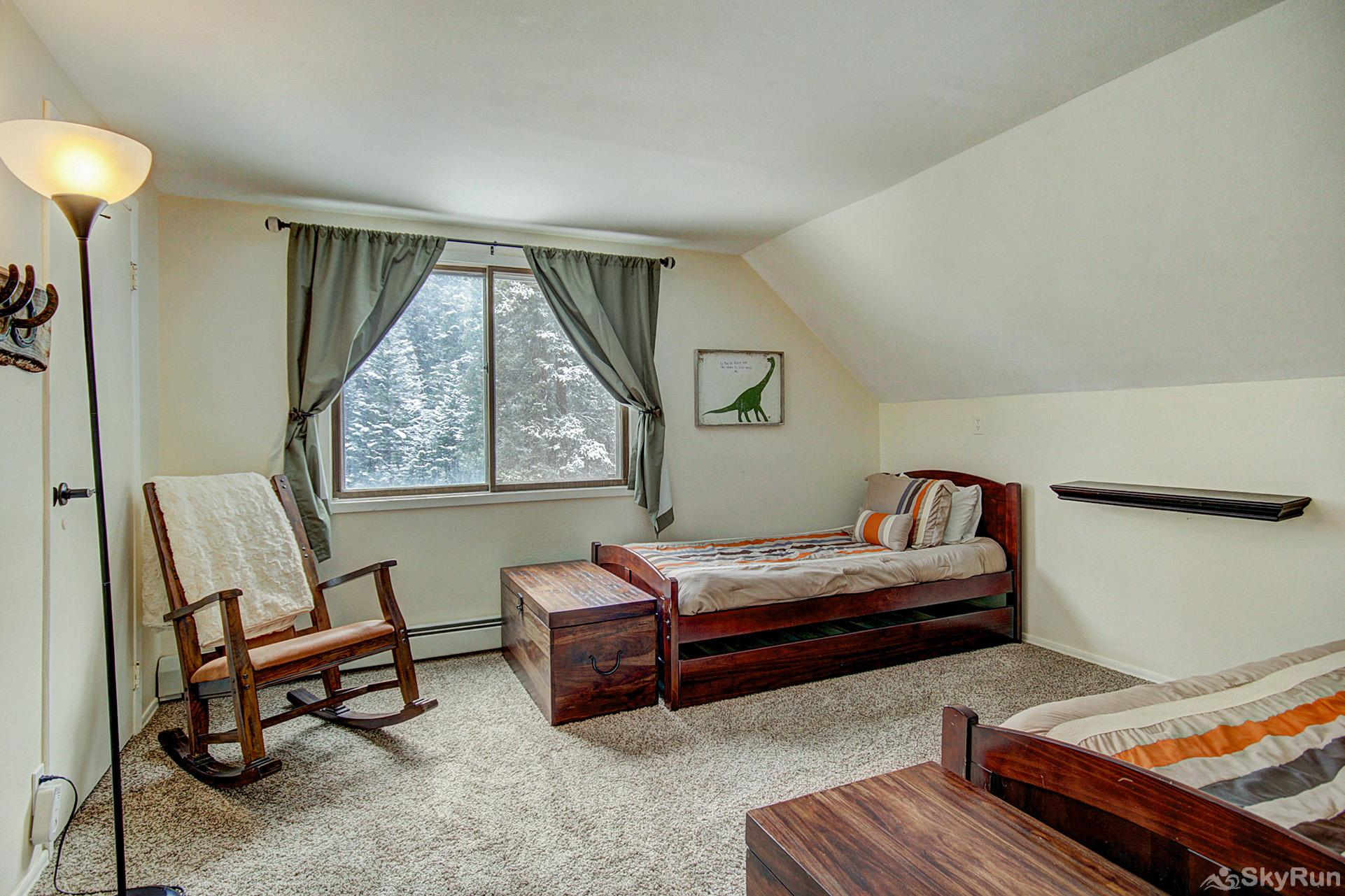 Lazy Dog Lodge Upper level bedroom with two twin beds and twin trundle