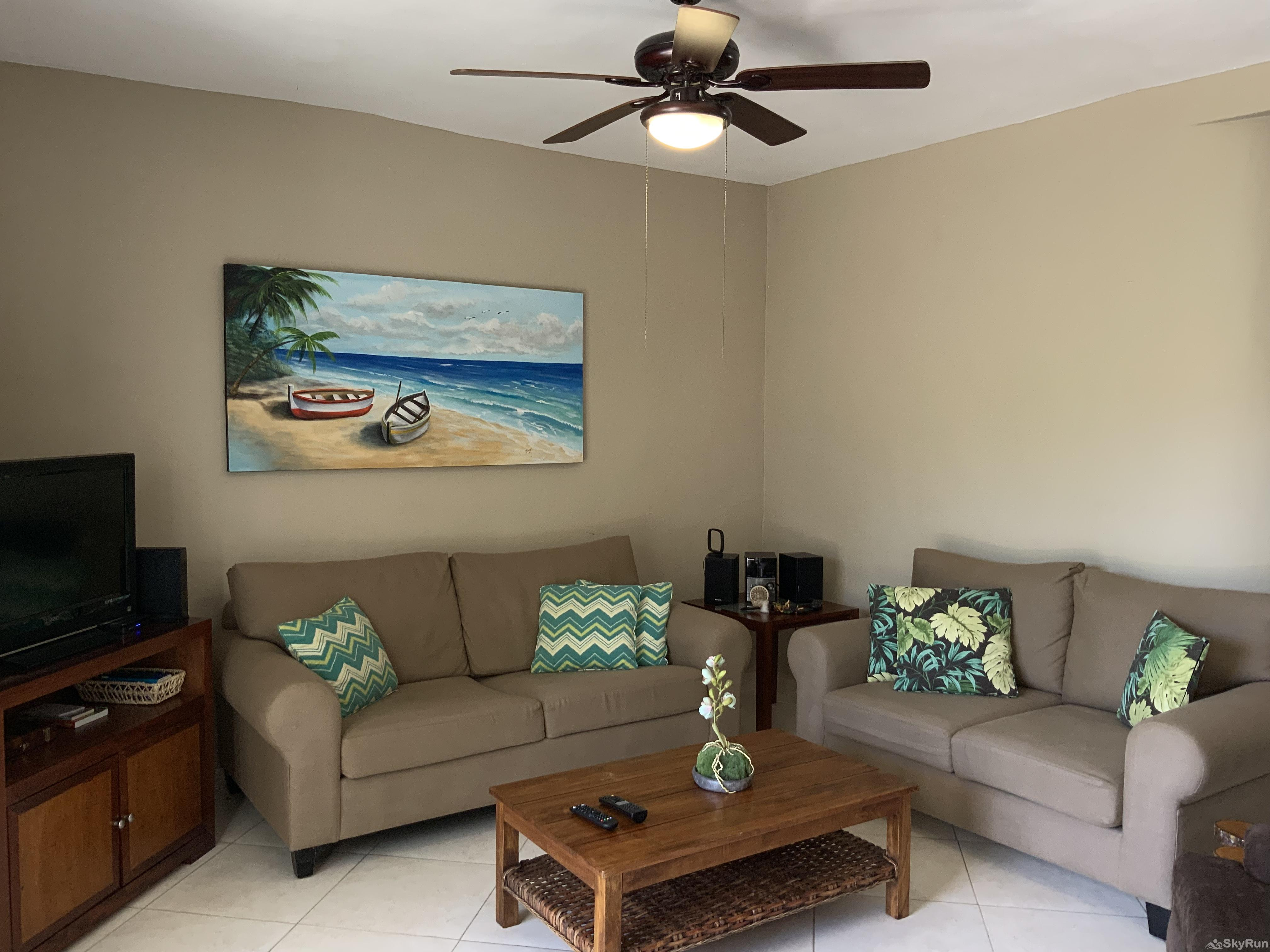 Beach Condo Casa de Canciones Rosa Blanca Playacar 2bdr Outdoor Pool Condo Living room at Playacar by SkyRun