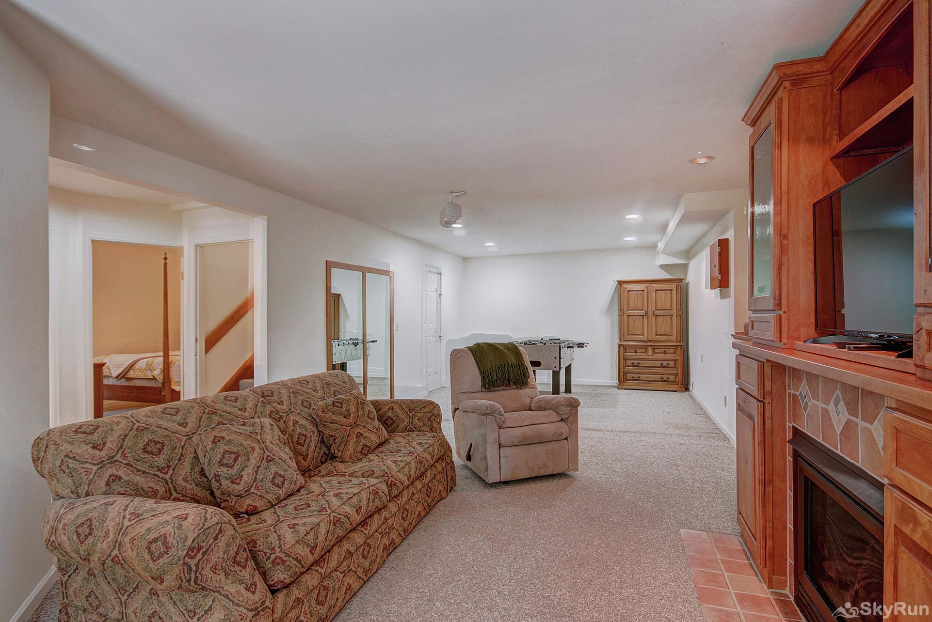 Aspen Heights Lodge Second living room in lower level with flat screen TV, foosball table