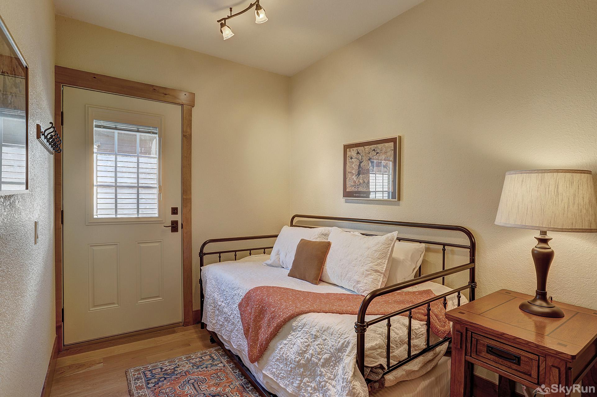 Happy Trails Main level twin bedroom with additional twin trundle bed
