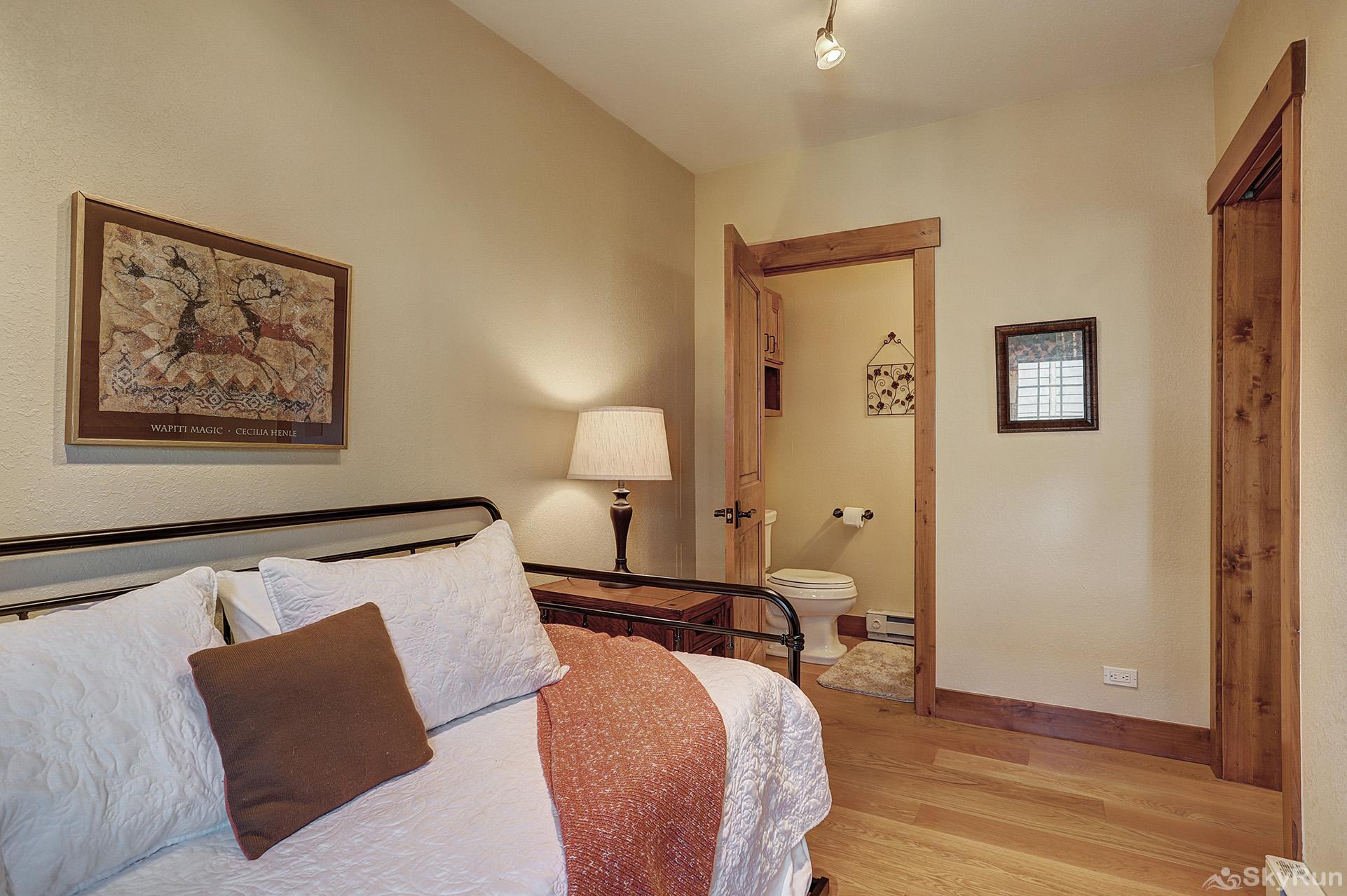 Happy Trails Main level twin bedroom with ensuite half bath