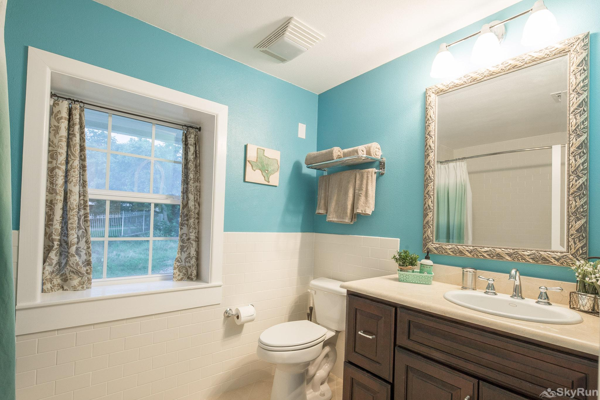 WATERFRONT GRACE First bathroom with shower/tub combo