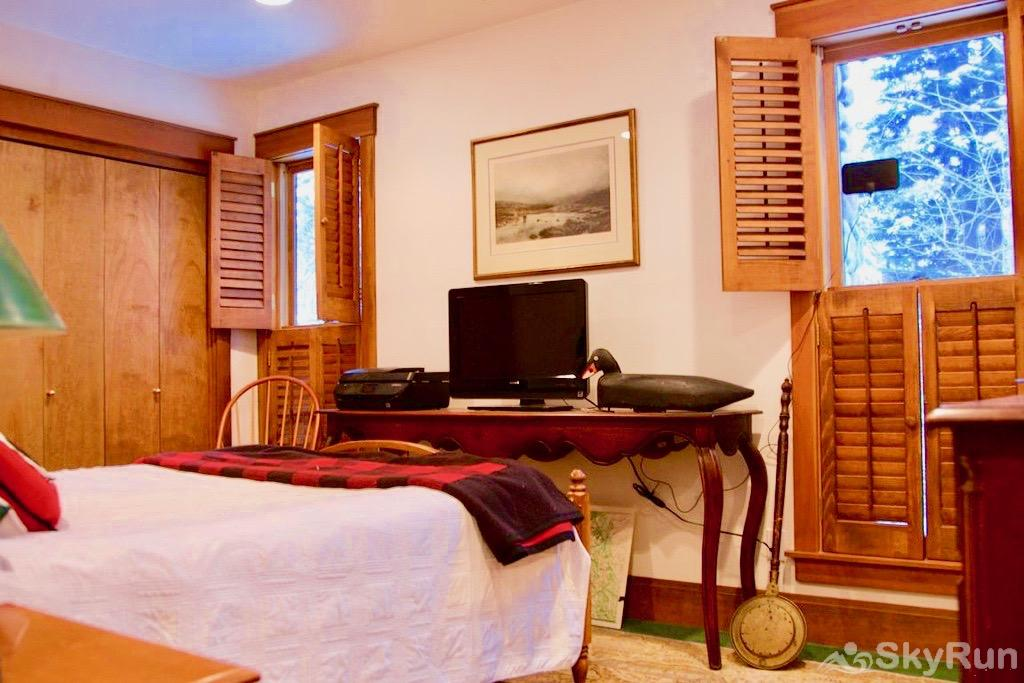 Whispering Pines Chalet Third bedroom boasts a queen bed and private bathroom.