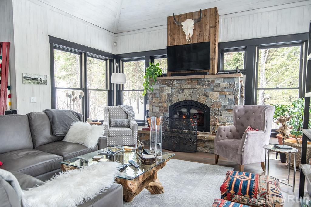 Whispering Pines Chalet Enjoy your coffee on the living room couch and watch the snow come down.