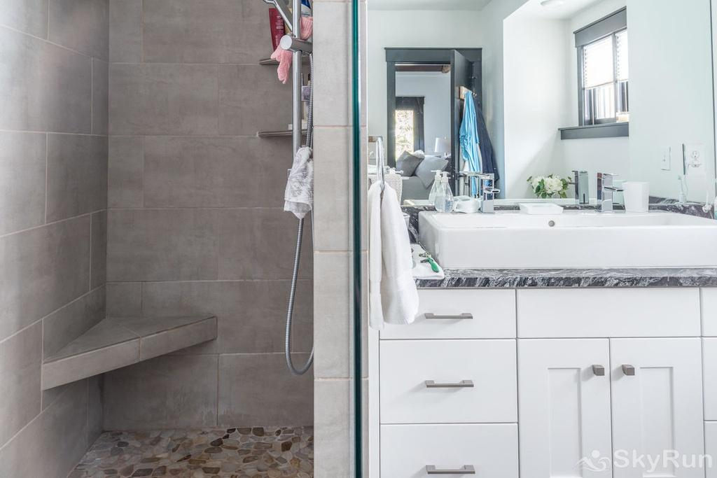Whispering Pines Chalet Master suite shower and sink.