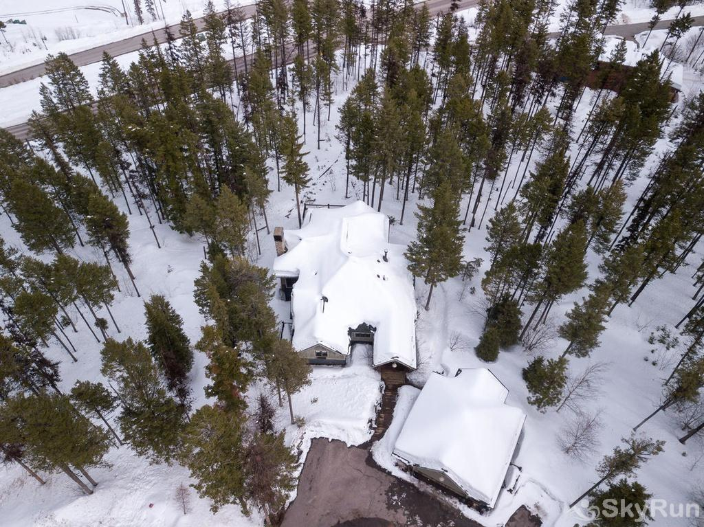 Whispering Pines Chalet Trees surround this magnificent property.
