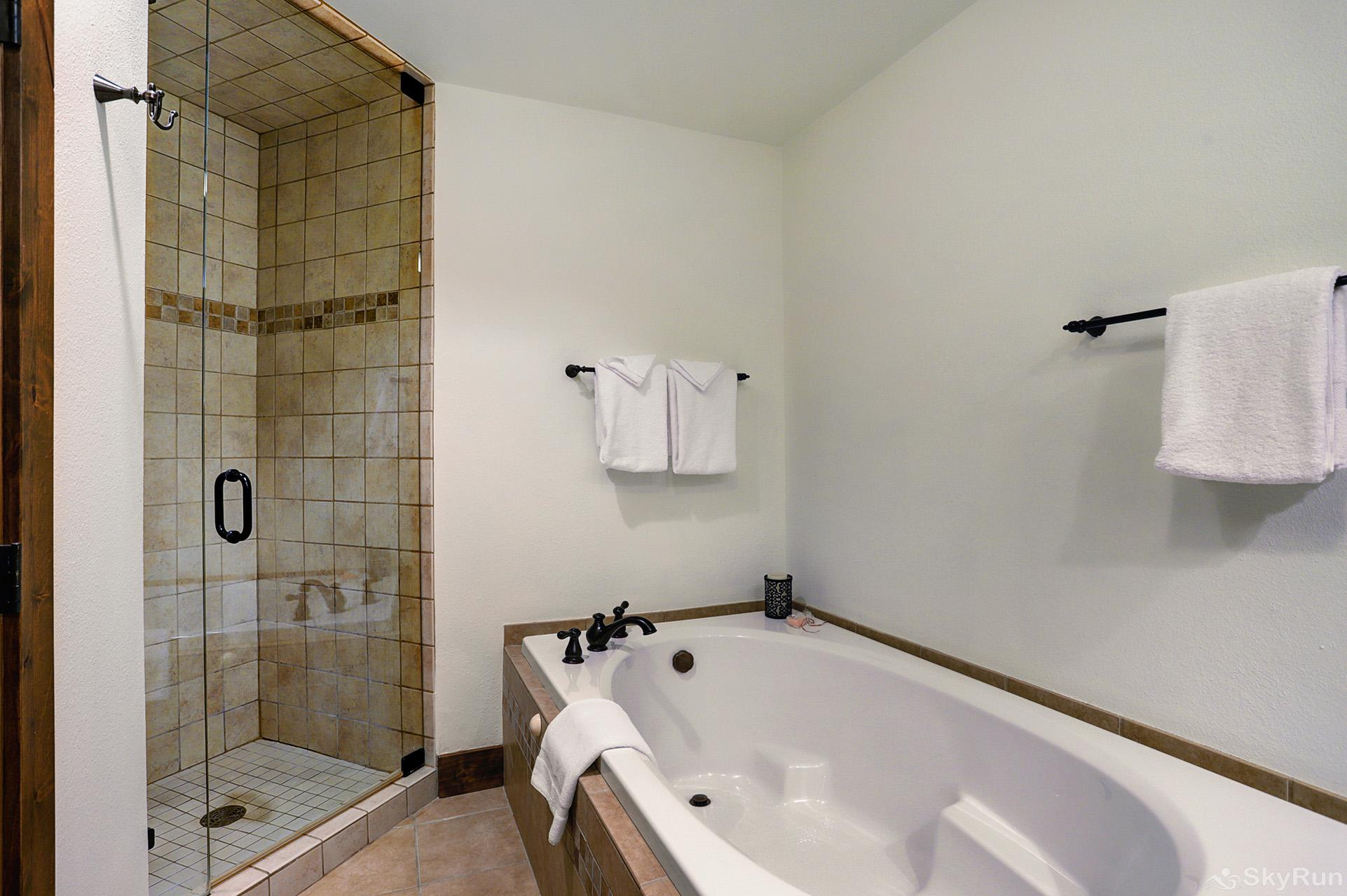 Village at Breck Chateaux 1022 King master ensuite bathroom with jetted tub and walk-in shower
