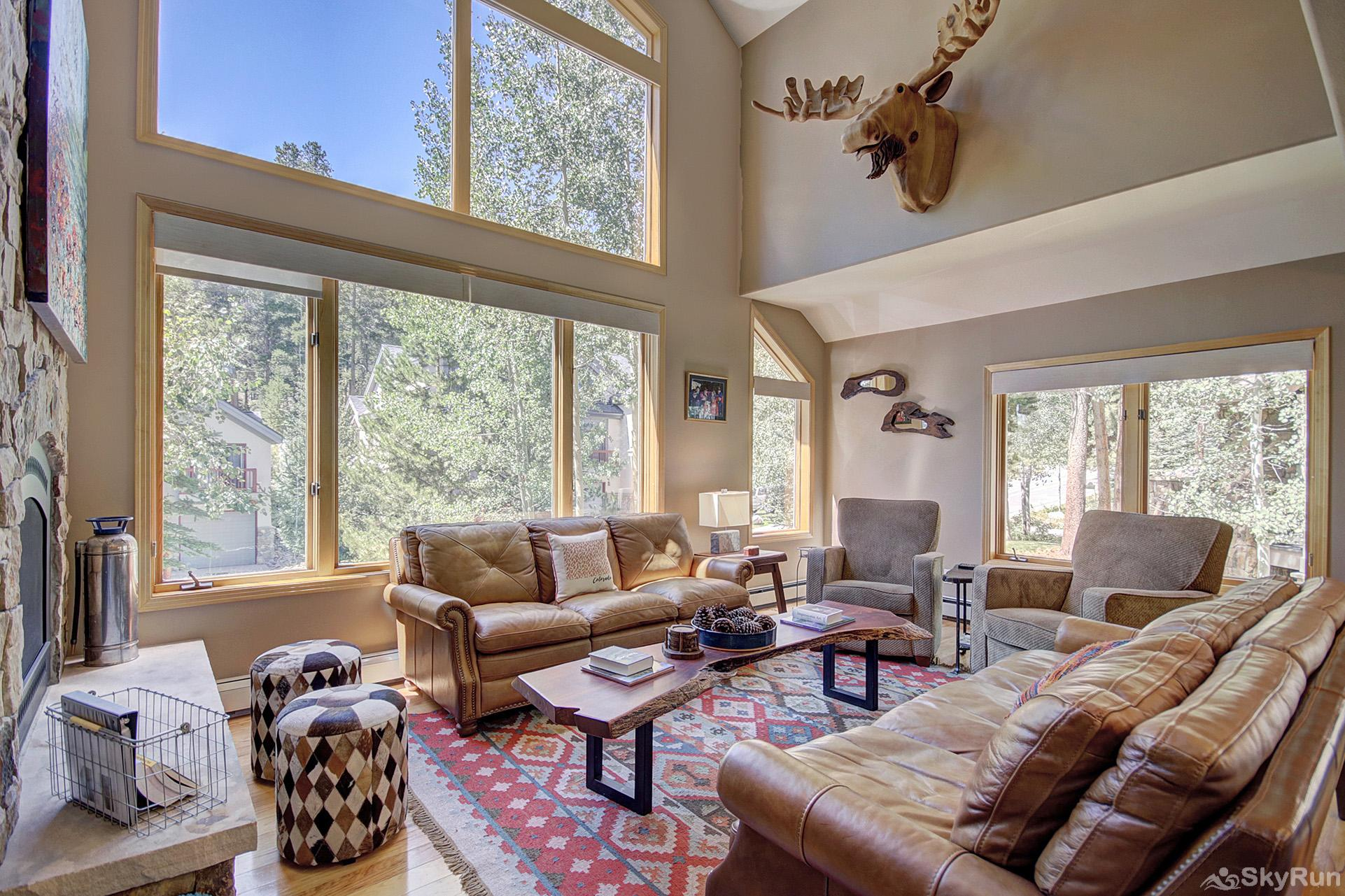 Tall Pines Lodge Living room with large windows to enjoy the forest views
