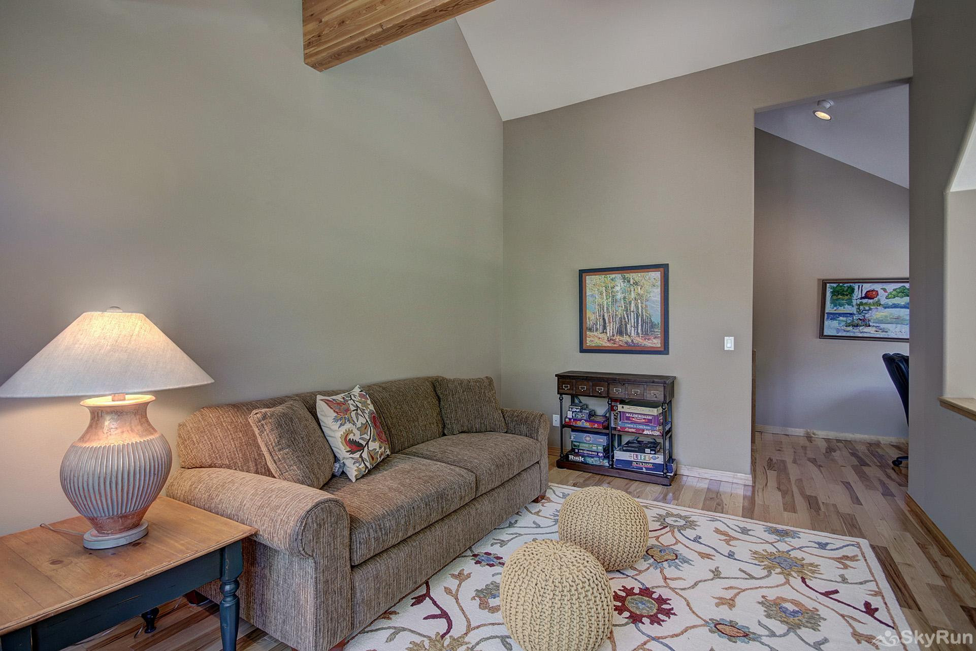 Tall Pines Lodge Upper level loft with queen sleeper sofa