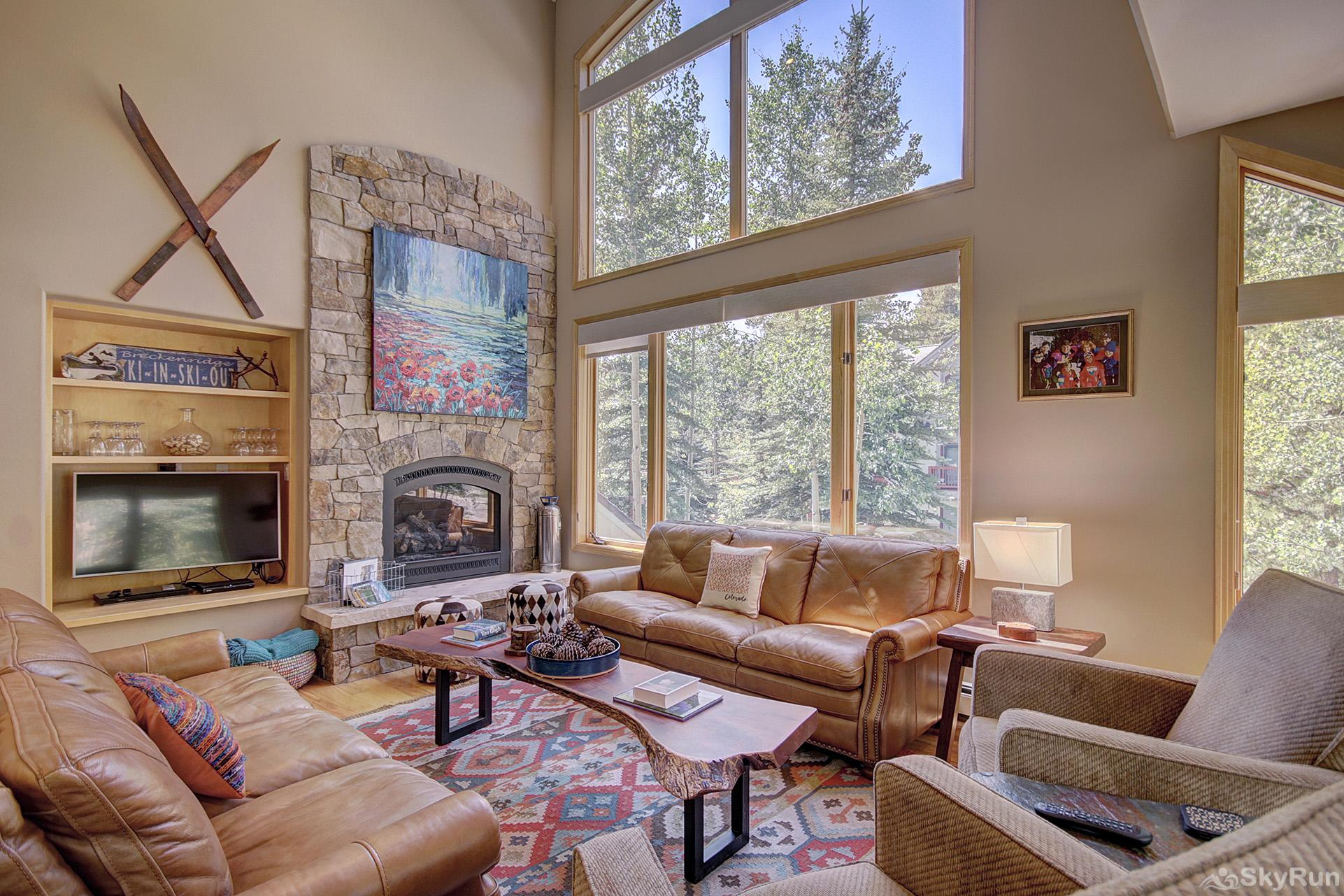 Tall Pines Lodge Luxurious living room with lofted ceilings and floor to ceiling windows