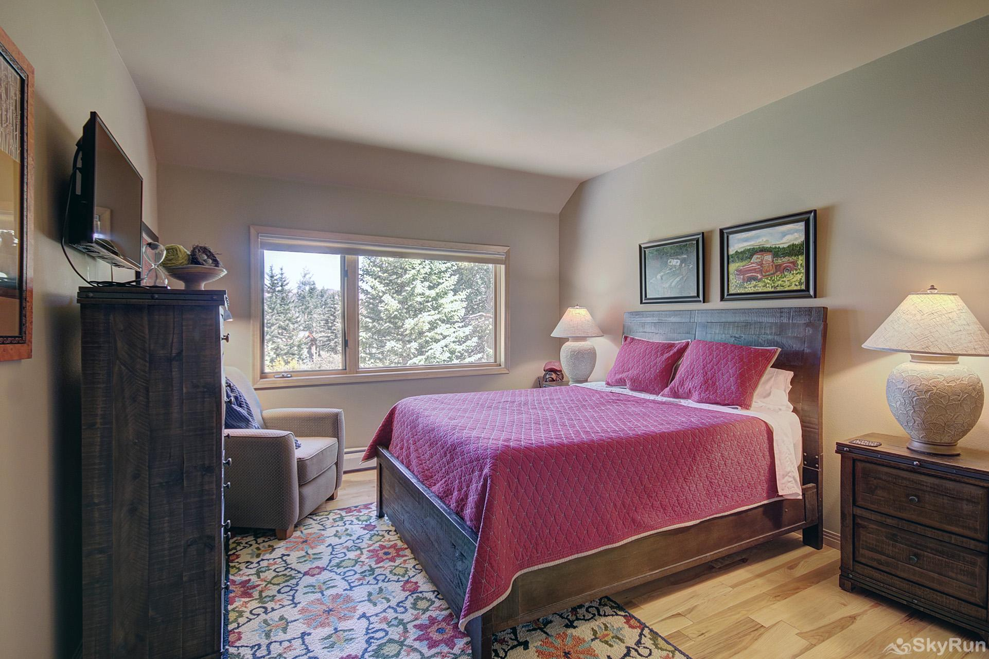 Tall Pines Lodge Upper level bedroom with double bed, flat screen TV