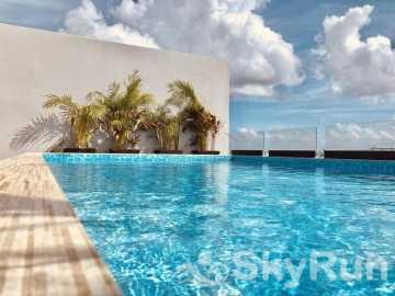NEW LUXURY BEACH VIEW CONDO 2 BD/2Bth Mins from Beach PDC safari outdoor pool
