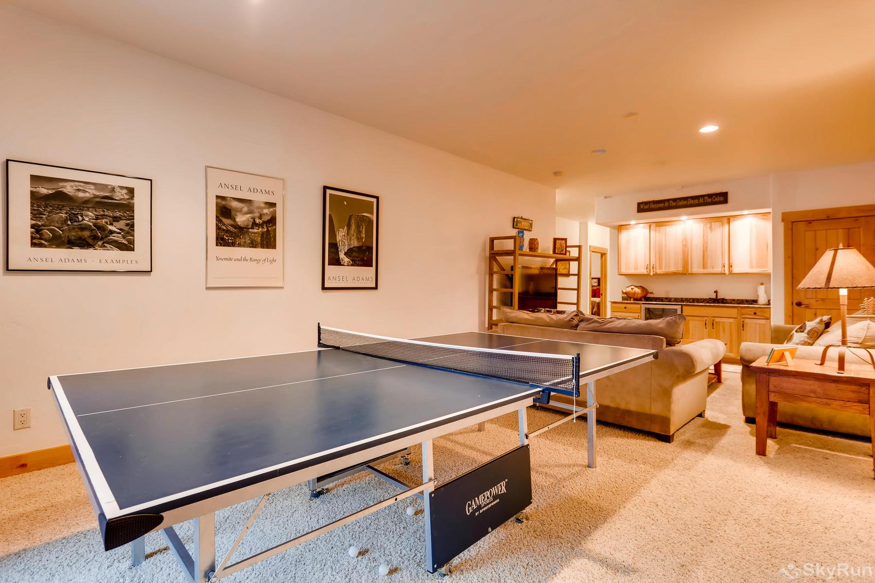 Nangle Woods Retreat Lower level game room with ping pong table