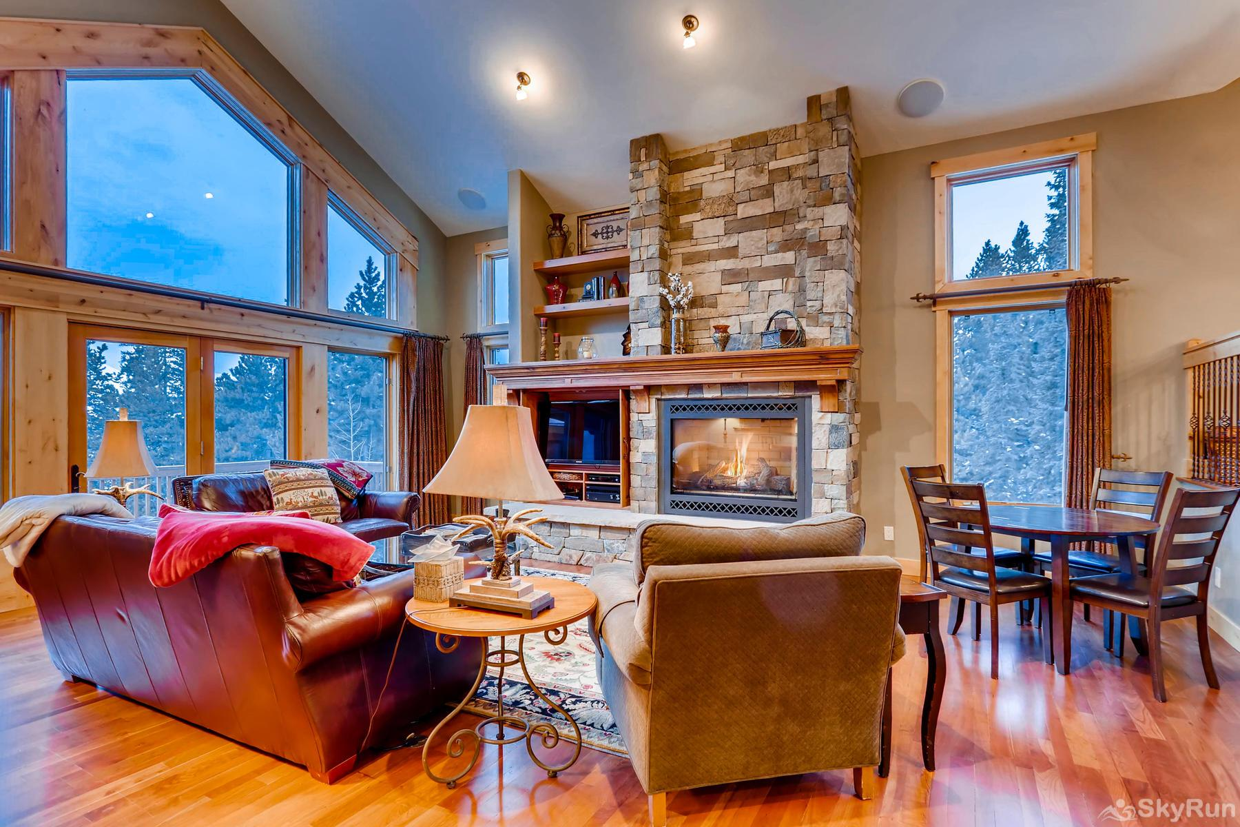Nangle Woods Retreat Luxurious living room with lofted ceilings and large windows to enjoy the views!