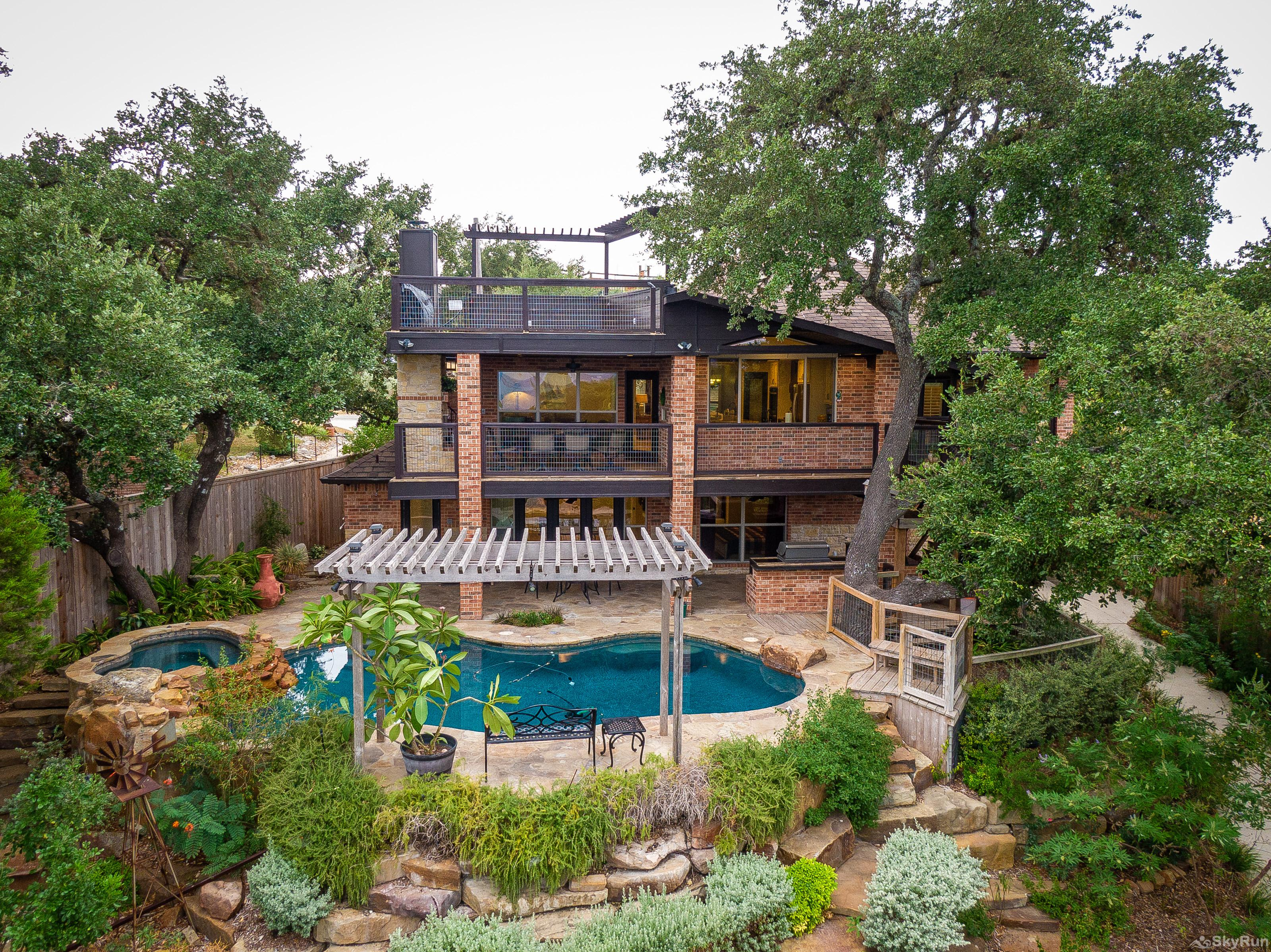 HUMMINGBIRD HIDEAWAY Backyard oasis with swimming pool, deck, and outdoor kitchen