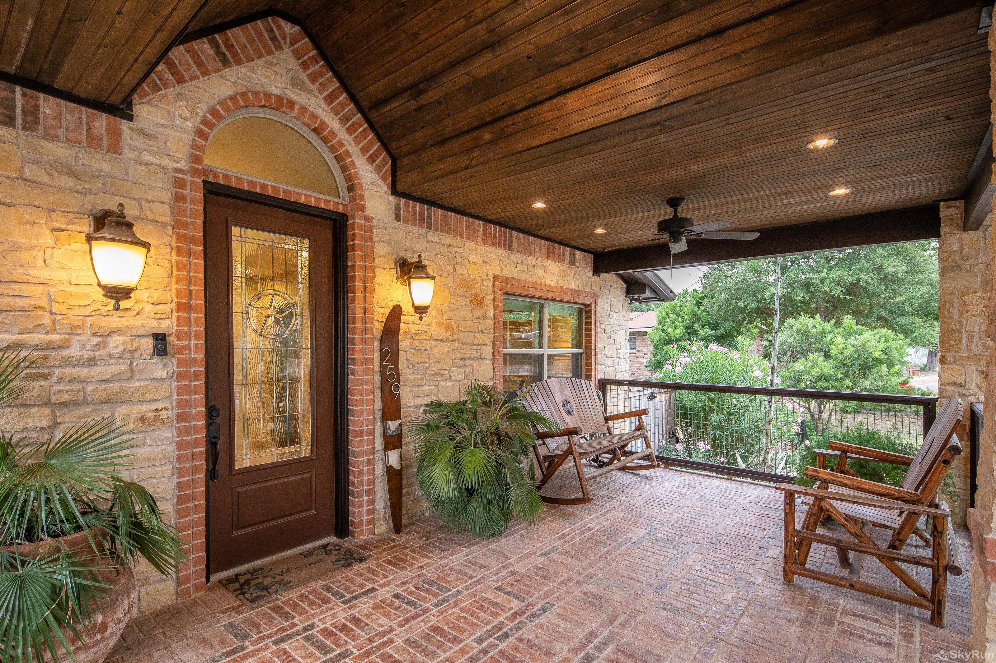HUMMINGBIRD HIDEAWAY Lovely front porch with brick flooring