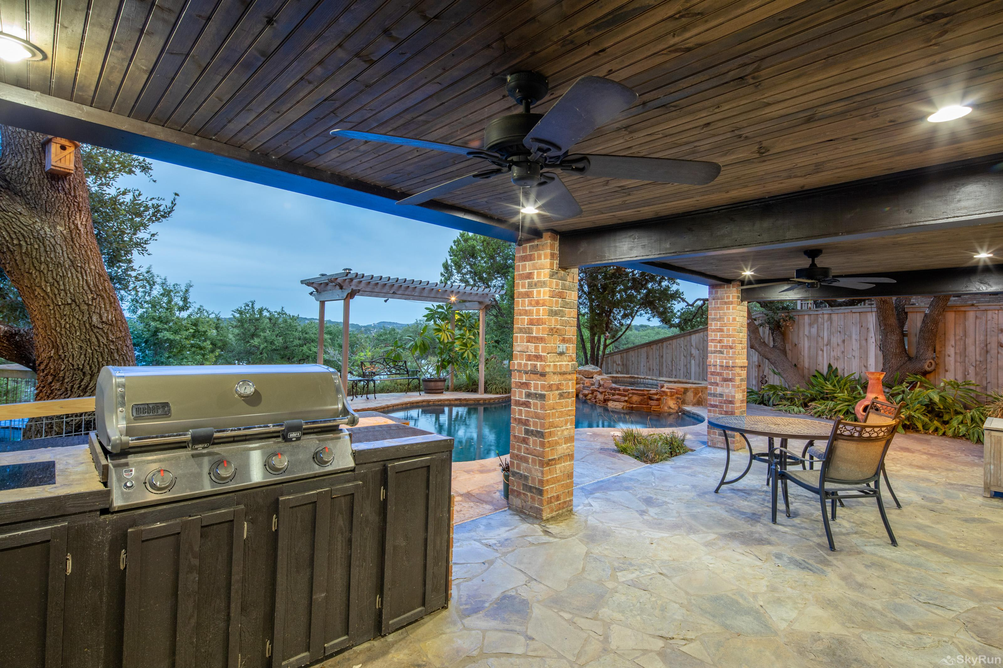 HUMMINGBIRD HIDEAWAY Covered poolside patio with grill and outdoor kitchen