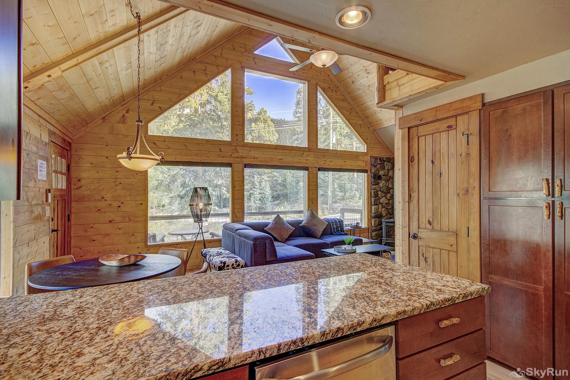Black Bear Chalet Kitchen looks out to dining and living room