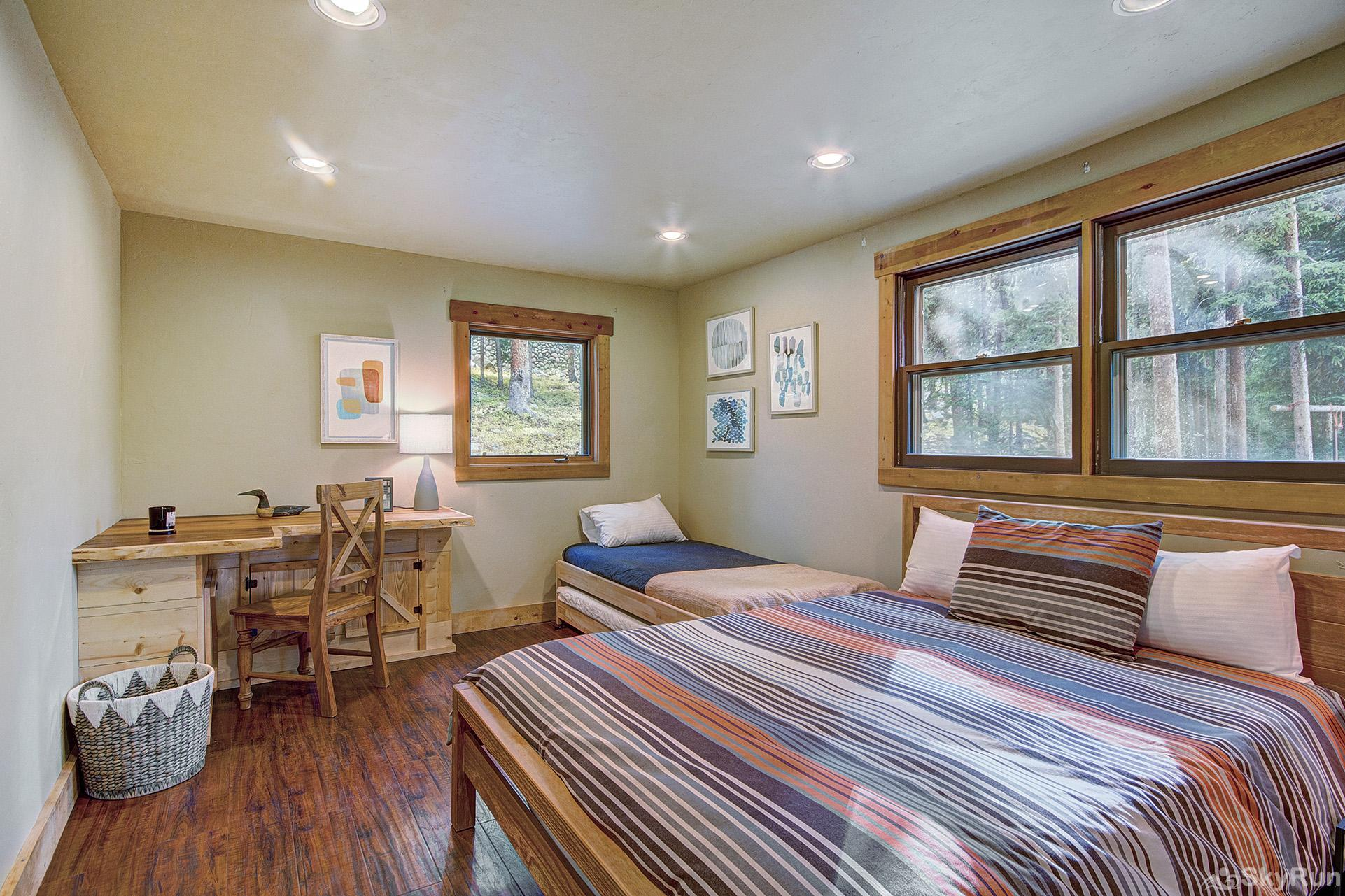 Black Bear Chalet Main level bedroom with queen and twin beds