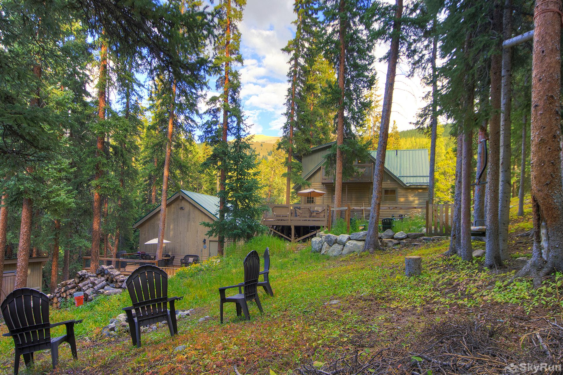 Black Bear Chalet Spacious backyard with wood fire pit