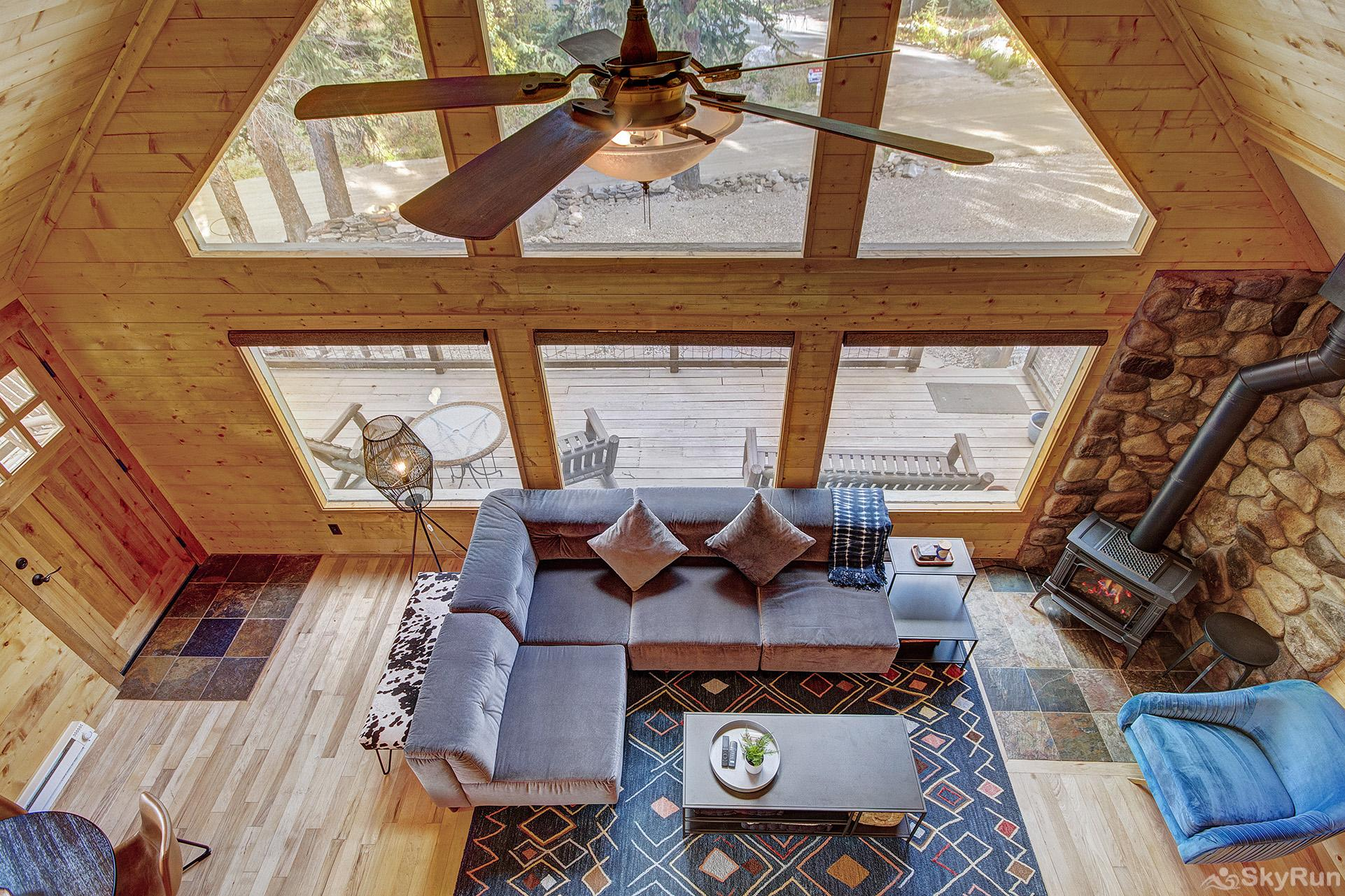 Black Bear Chalet Living room with lofted ceiling and floor to ceiling windows