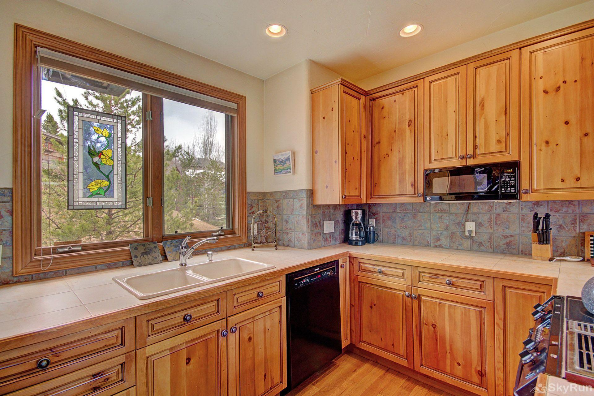 CrossTimbers 2784 This kitchen with a view is full of light and has a double sink, microwave, stove, dishwasher and oven.