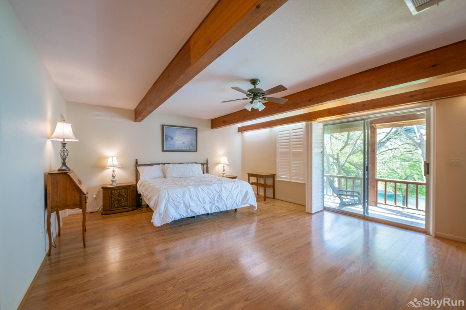 GUADALUPE RIVER GETAWAY Downstairs master bedroom with king bed