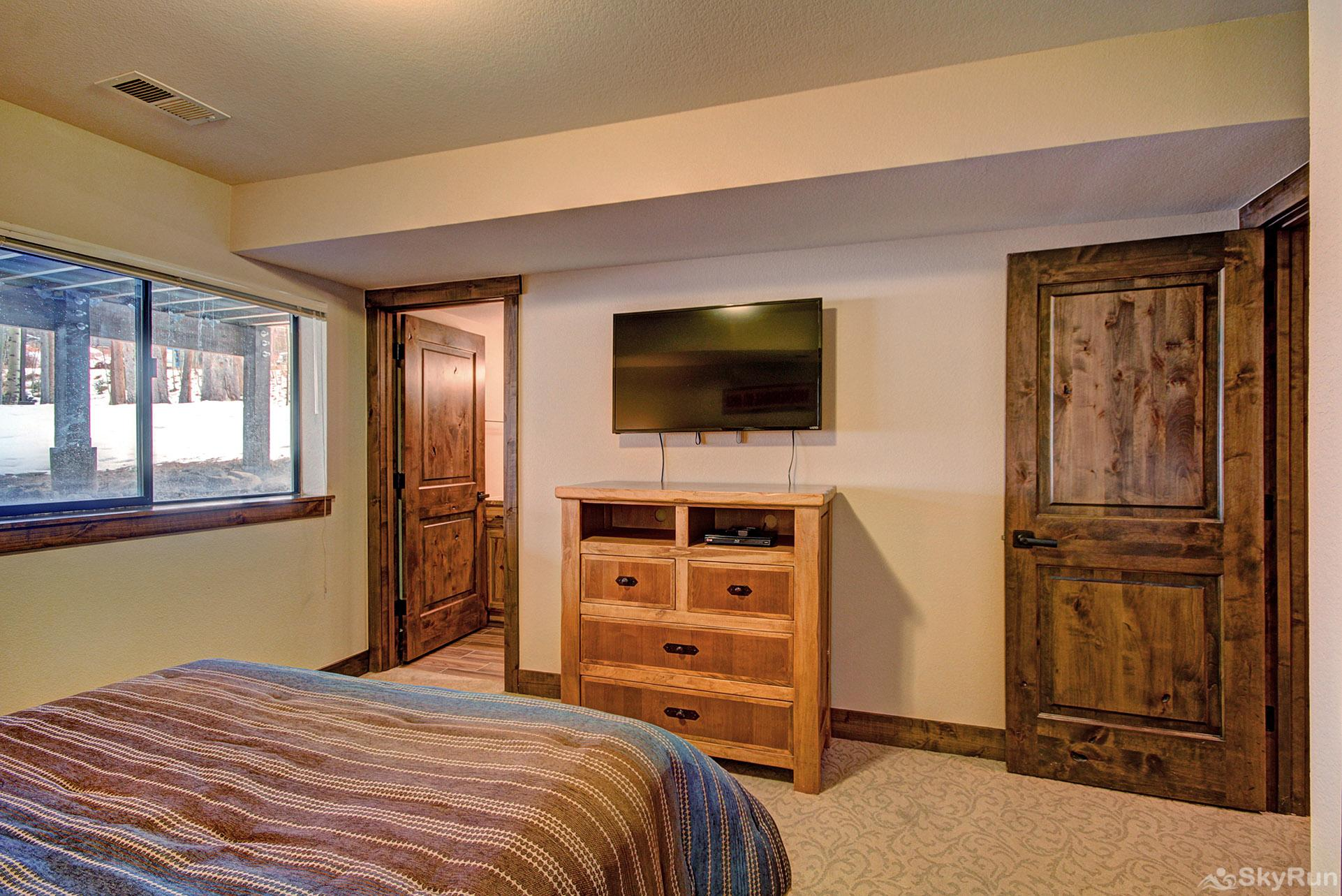 Village Point 109 Lower level queen suite features flat screen TV & ensuite bath