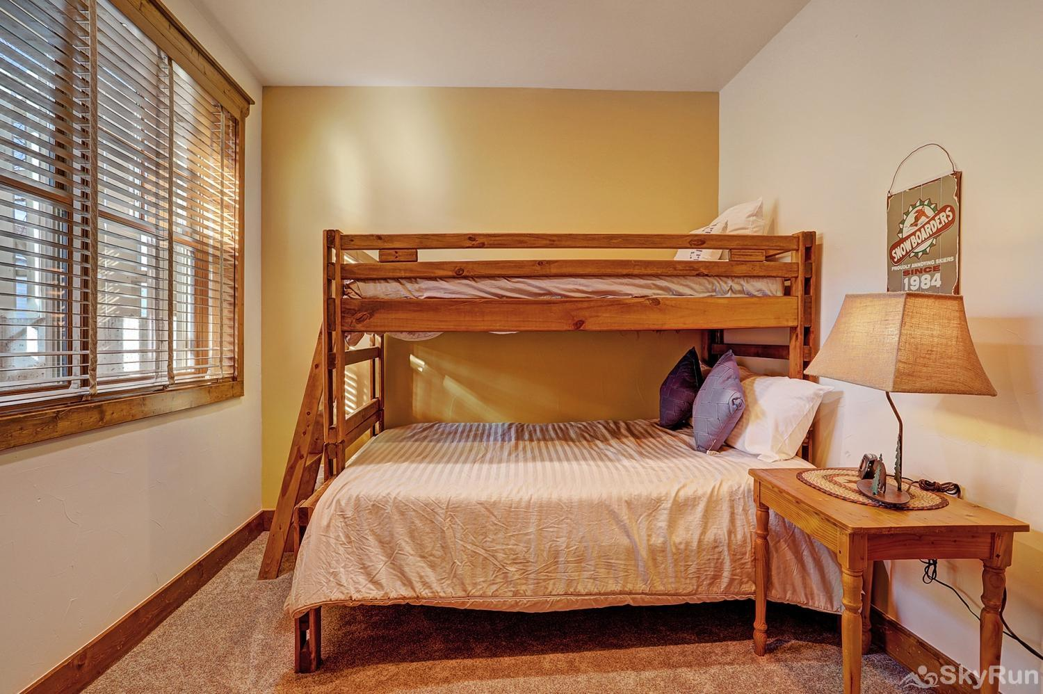 Mountain Ridge Chalet Lower level bunk room with ensuite bath