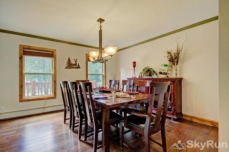 Grey Squirrel Lodge Great dining room table that seats 8 people and an additional bar seating for 4 more