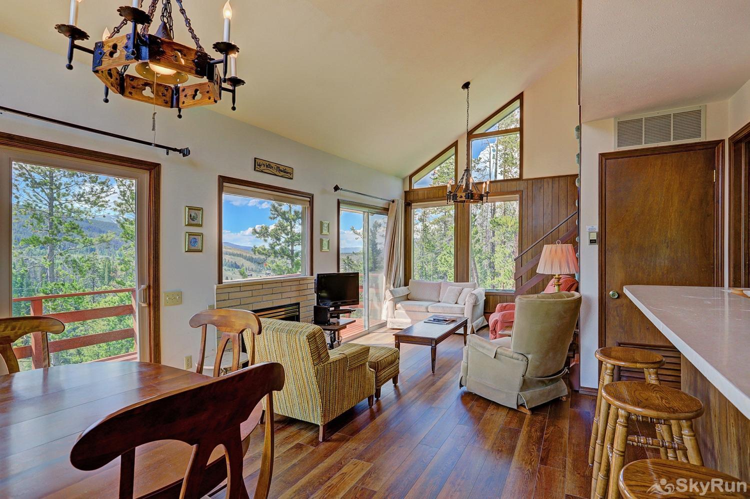 Elk View Cottage Cozy living area with large windows to provide ample natural light