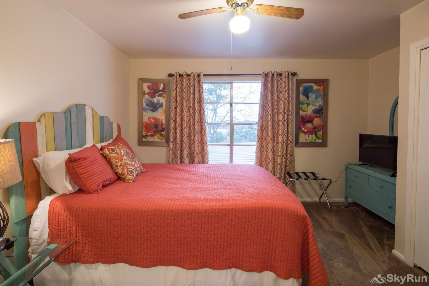 TEXAS ROSE LODGE First bedroom with comfy queen bed and TV