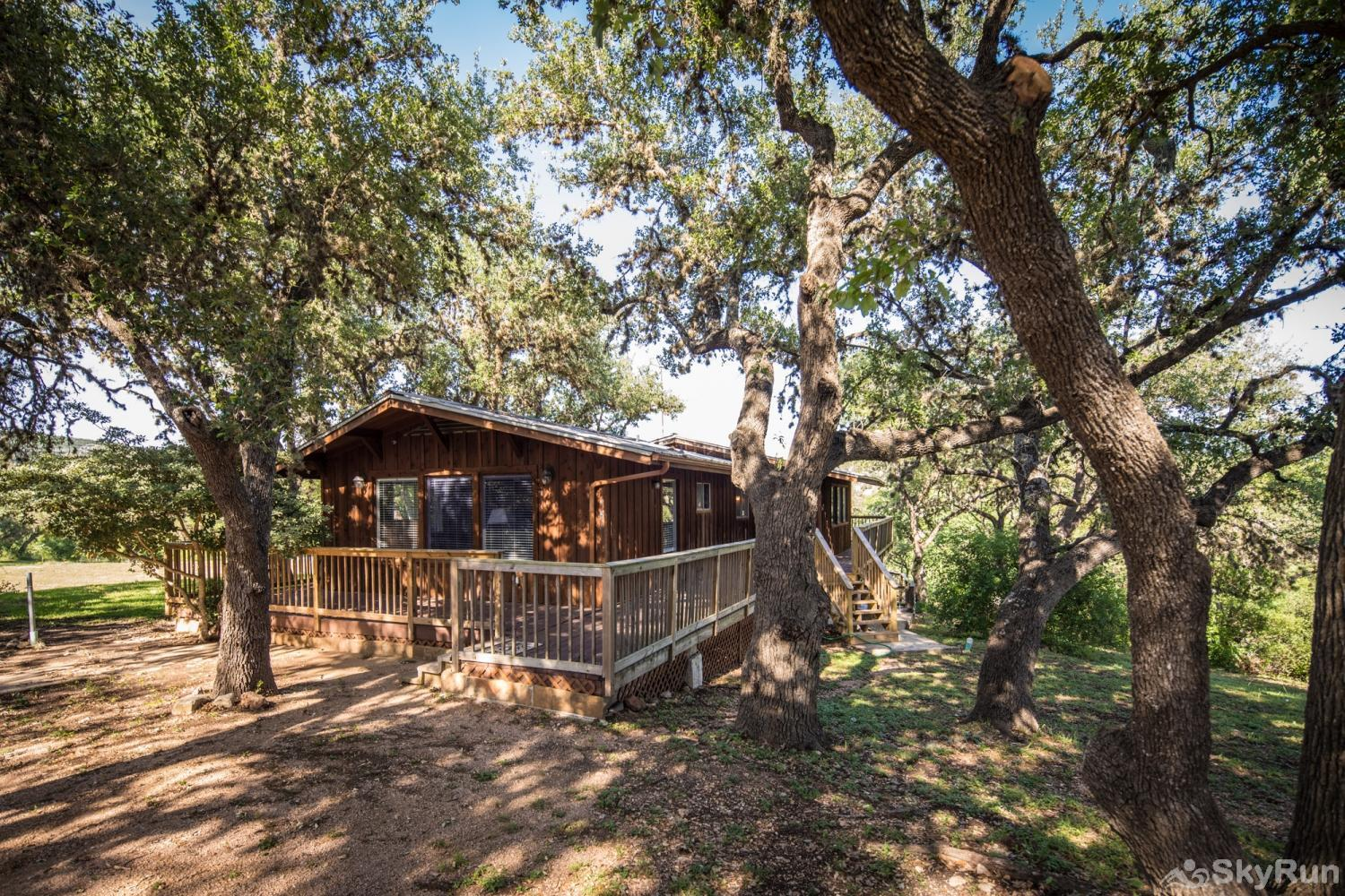 RICKS RIVER HAUS Front of Home with Huge Oak Trees
