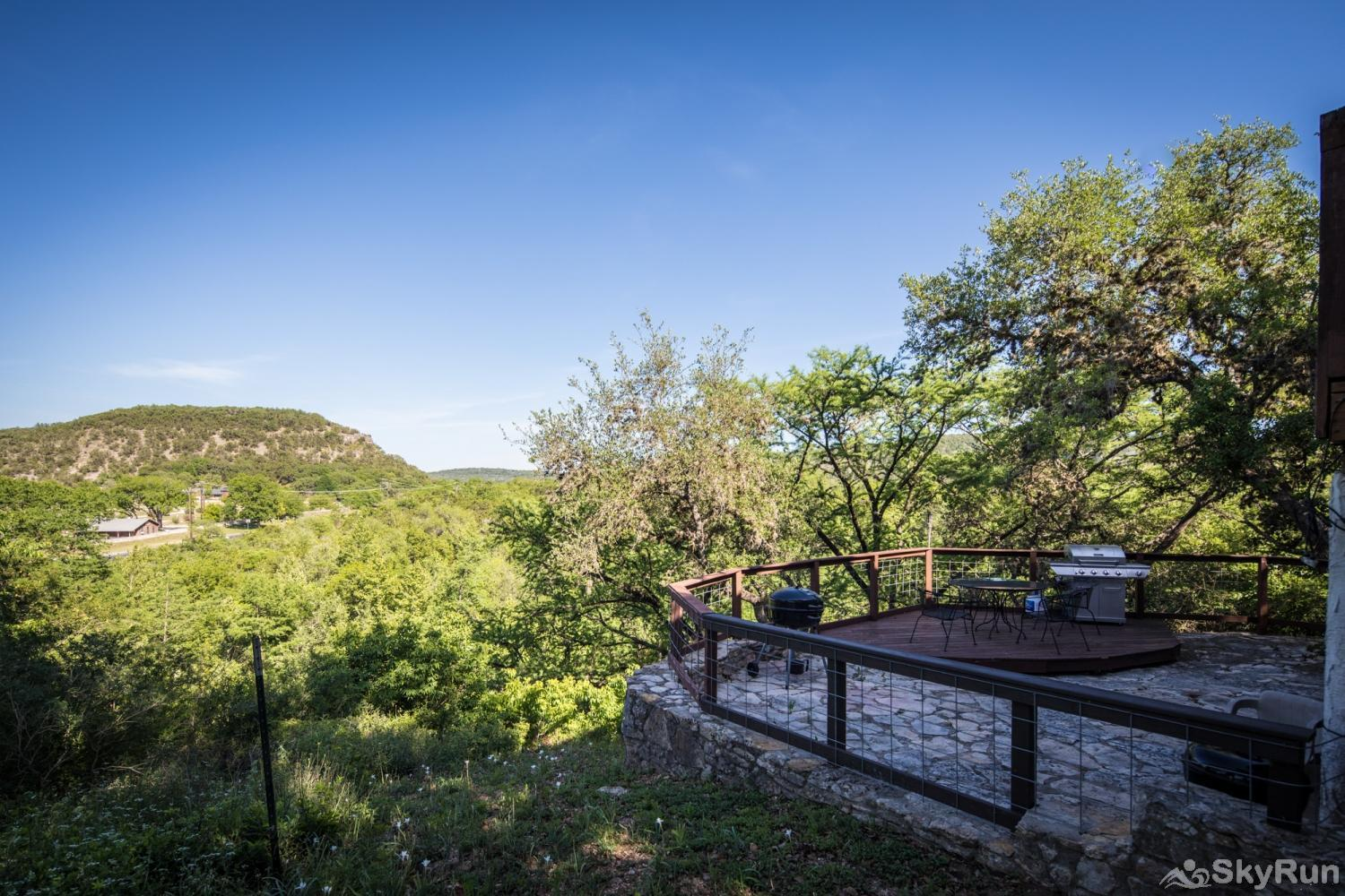 RICKS RIVER HAUS Guadalupe River and hillside view from the patio