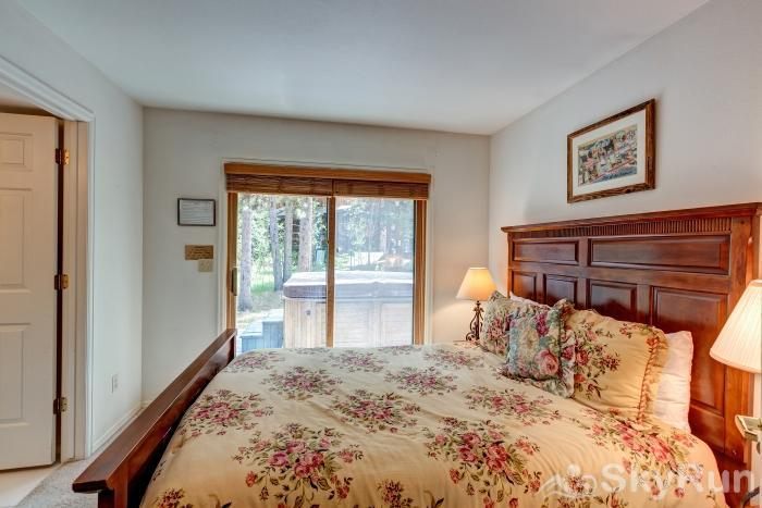 Pine Creek Lodge Lower level queen bedroom with ensuite bath
