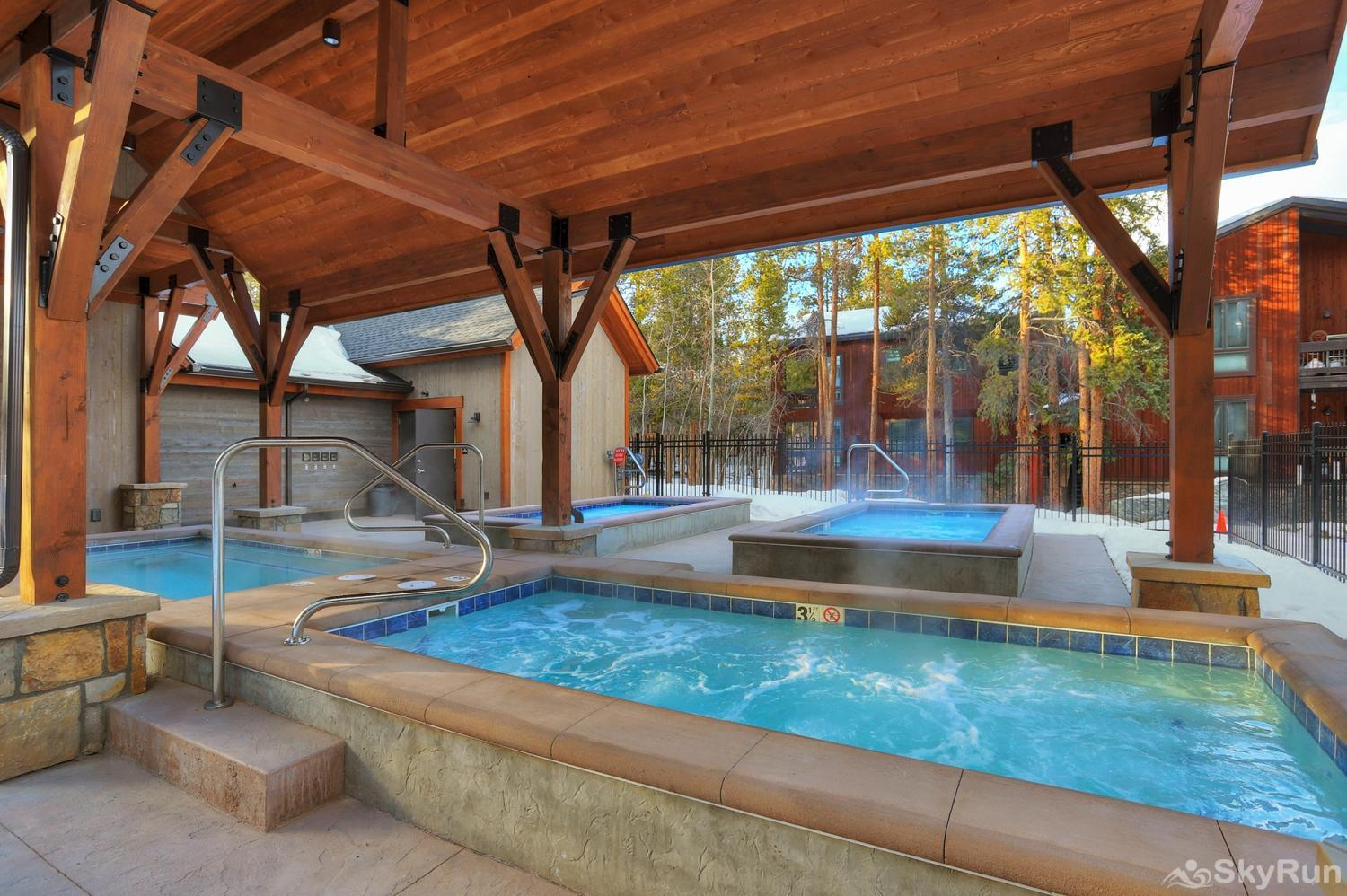 Pine Creek Lodge Soak in the outdoor hot tubs after a day of fun adventures!