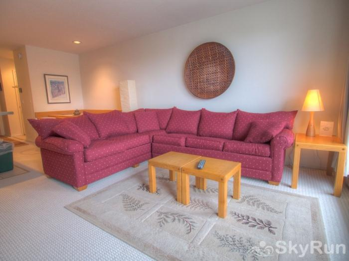21 Mountainside Living room area with large sectional couch
