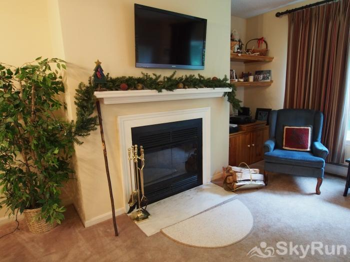 Slopeside Okemo Condo Open living room with wood fireplace