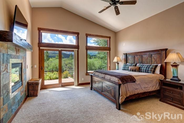 Swan River Retreat Bedroom #1 - Master suite with fireplace and access to patio