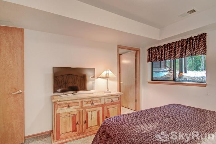 Village Point 303 Main level queen bedroom with flat screen TV