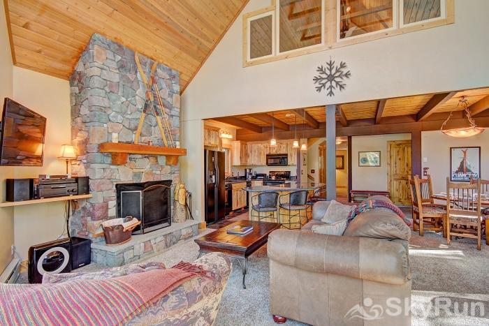 Wildernest Point Spacious living room area with wood burning fireplace