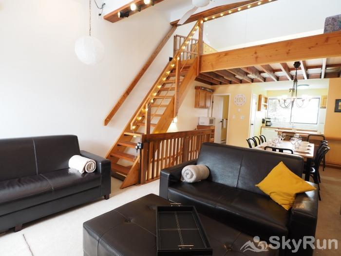 Strayhorse Townhouse #12 The open ceiling and exposed wood beams create an incredible ski cabin feel