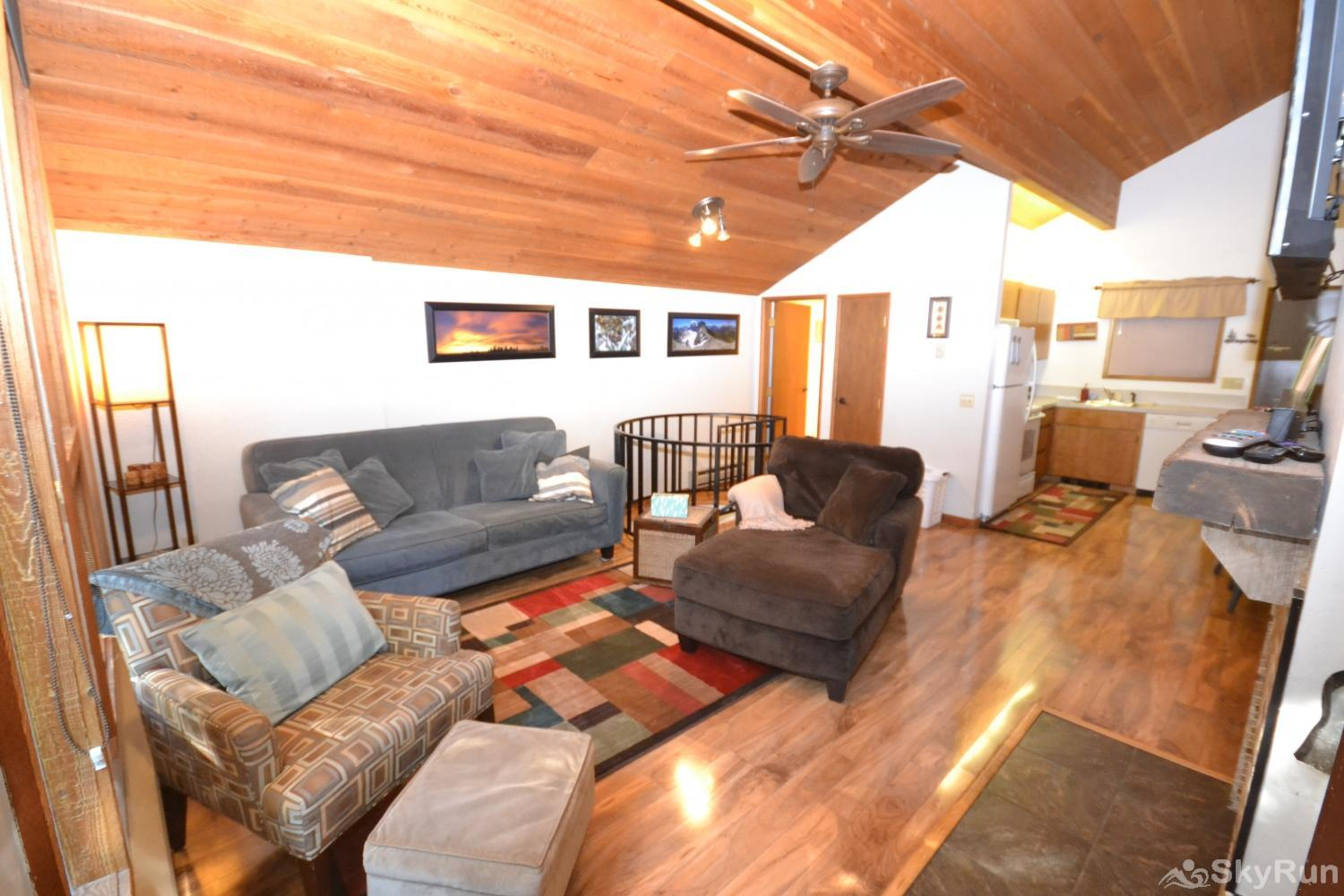 Ptarmigan Village 86 Open living room and kitchen; wood fireplace and large TV