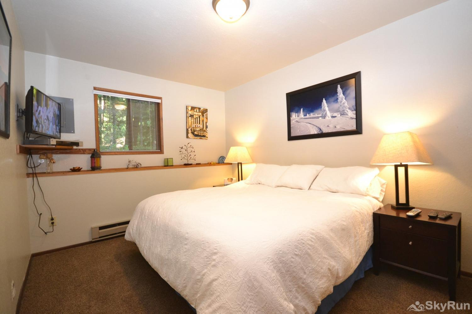 Ptarmigan Village 86 First bedroom with King sized bed and TV