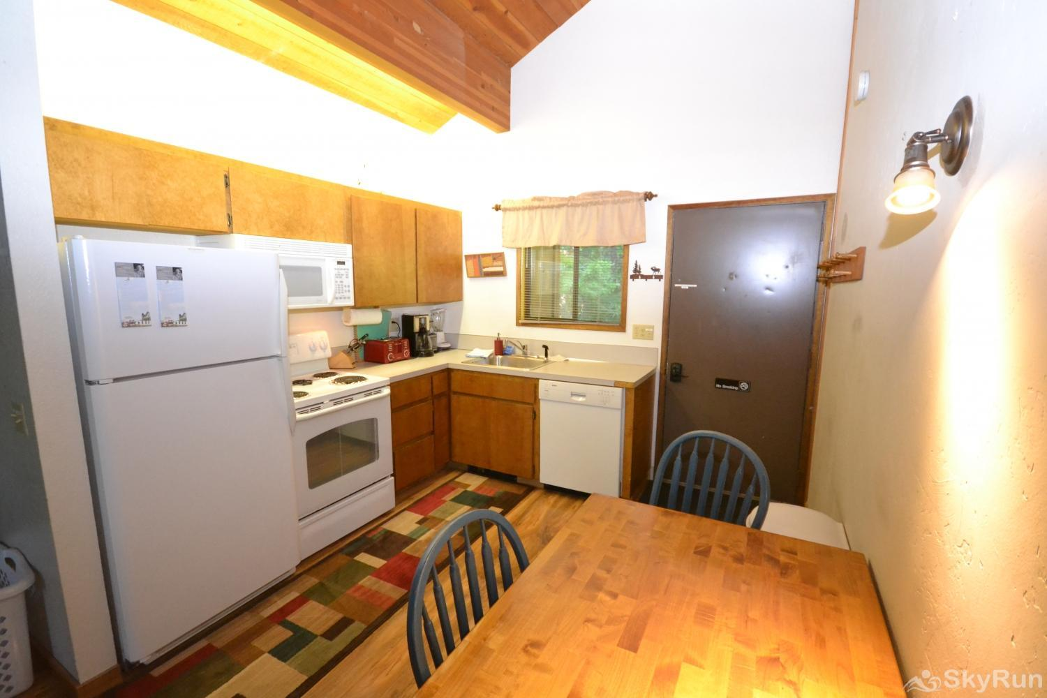 Ptarmigan Village 86 Open kitchen with dining table
