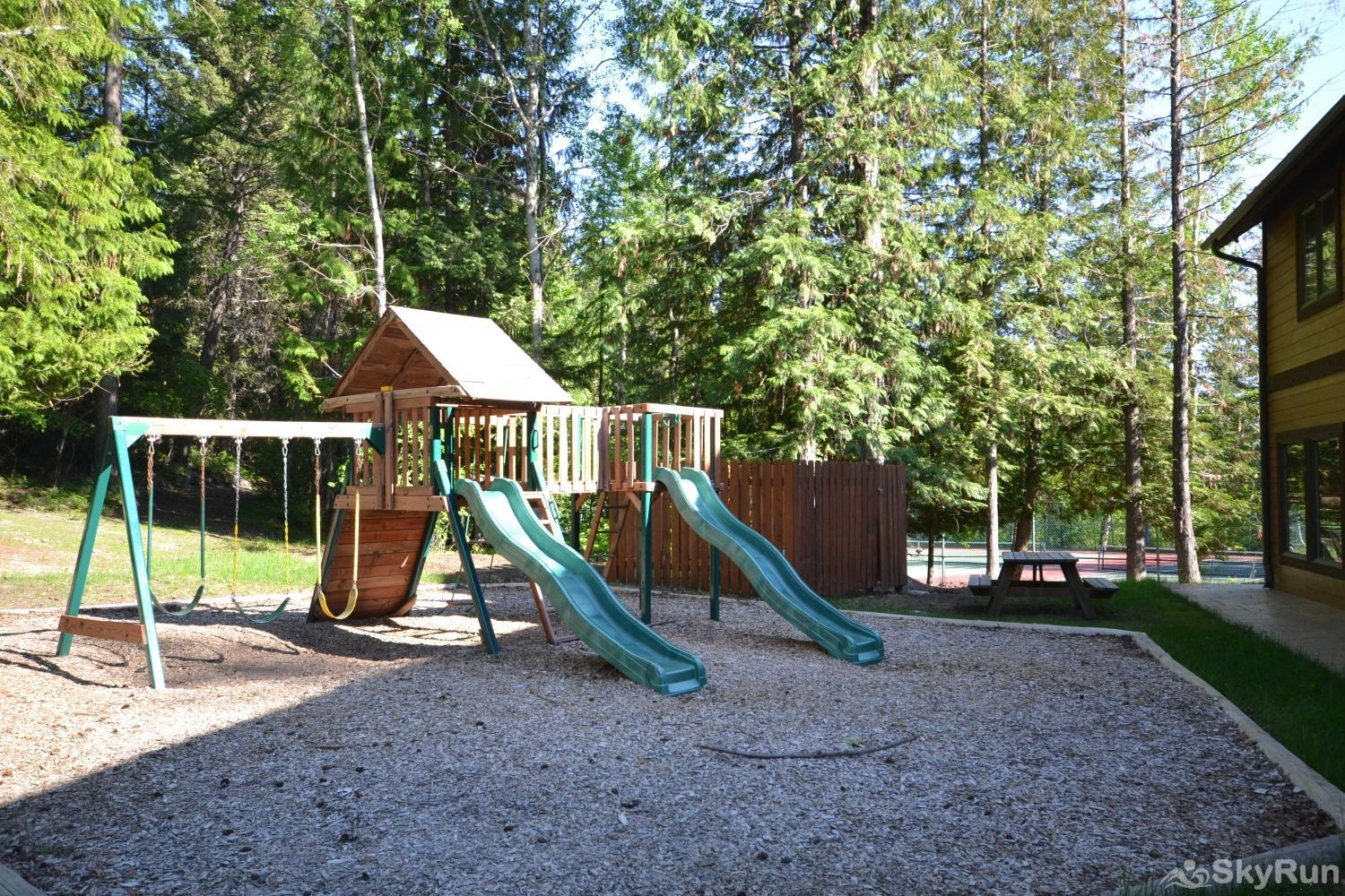 Ptarmigan Village 86 Playground next to tennis courts and indoor pool