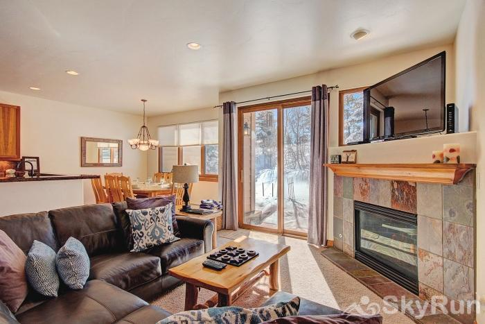Highland Greens Pine Open floor plan living area with sliding glass doors to your private deck