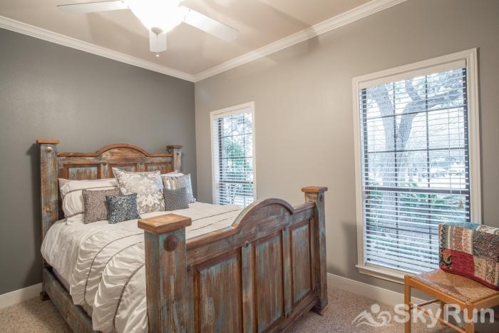 GRUENE VISTA ON THE GUADALUPE Third Downstairs Bedroom with Queen Bed