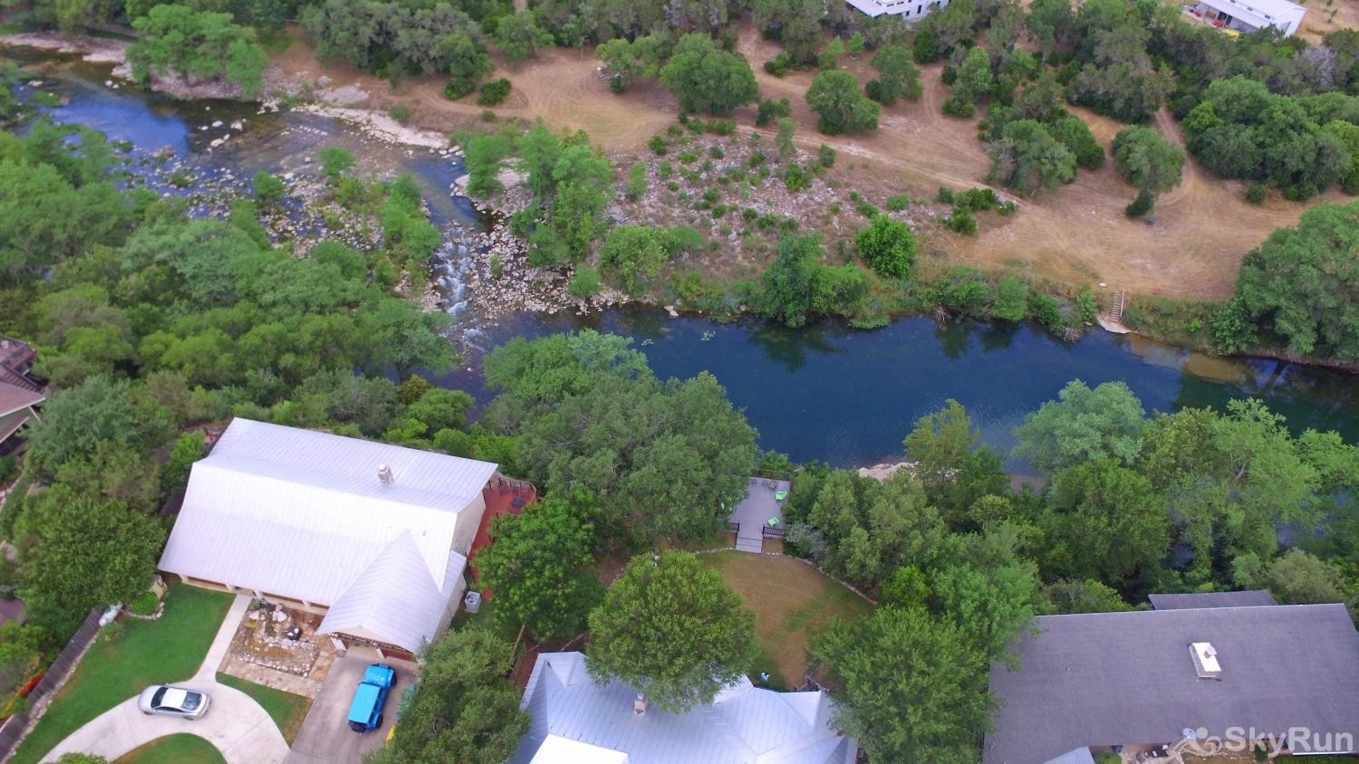 GRUENE VISTA ON THE GUADALUPE Aerial View of Backyard and Deck, with the River Below