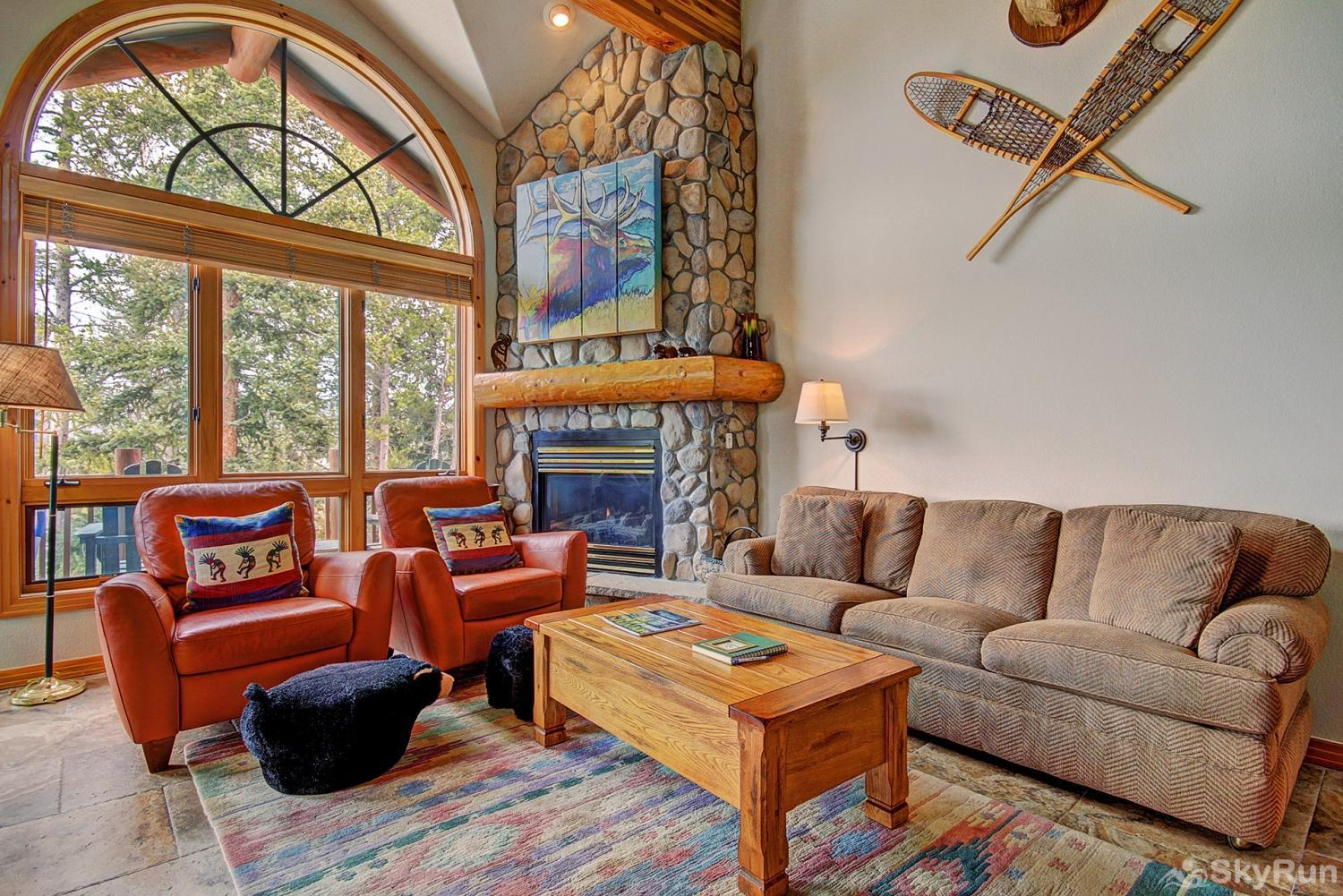 Elk Ridge Retreat Luxurious and cozy living area with gas fireplace and gorgeous windows